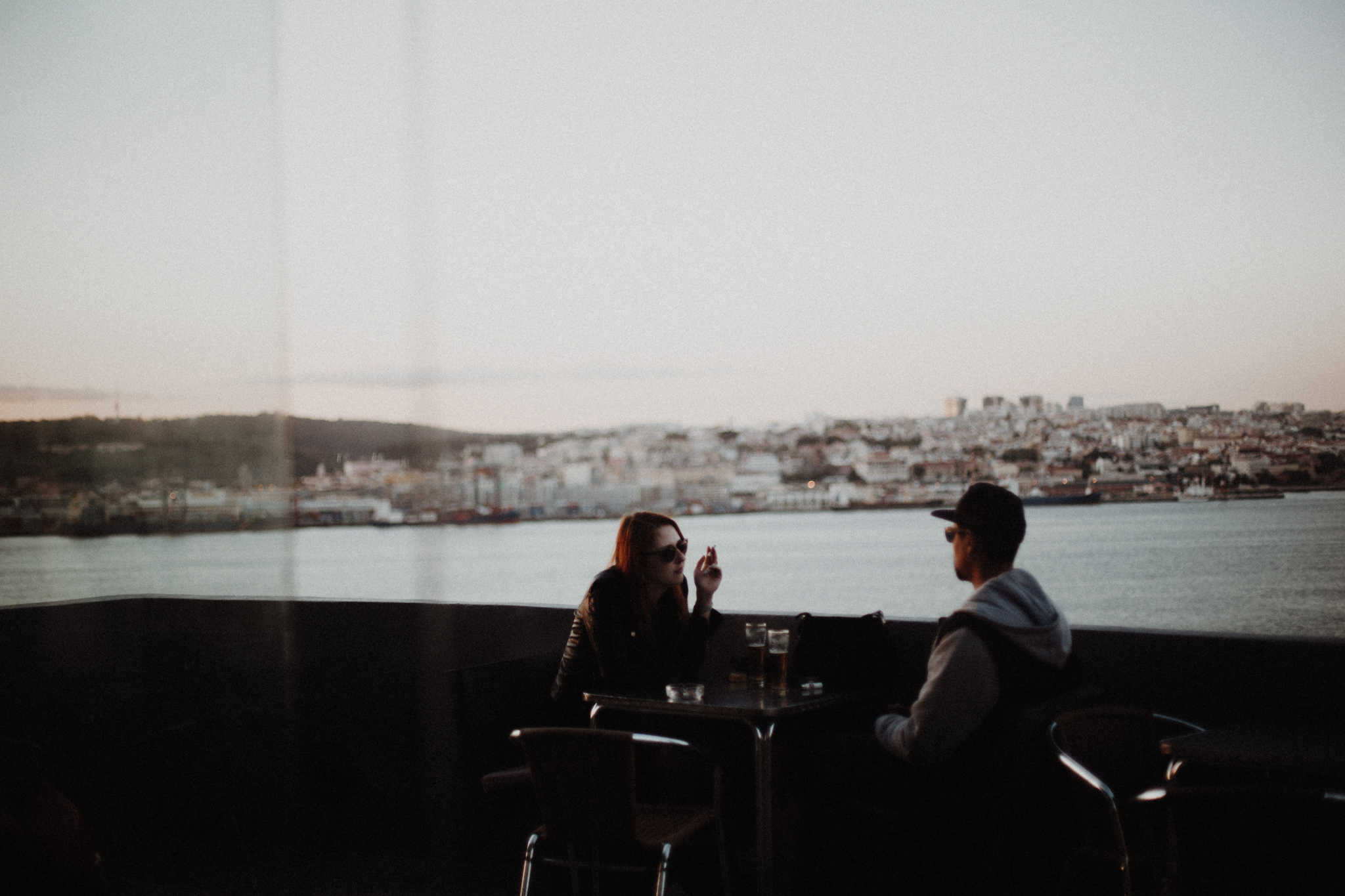 couple at Boca do Vento Miradouro Almada overlooking tagus rover to lisbon