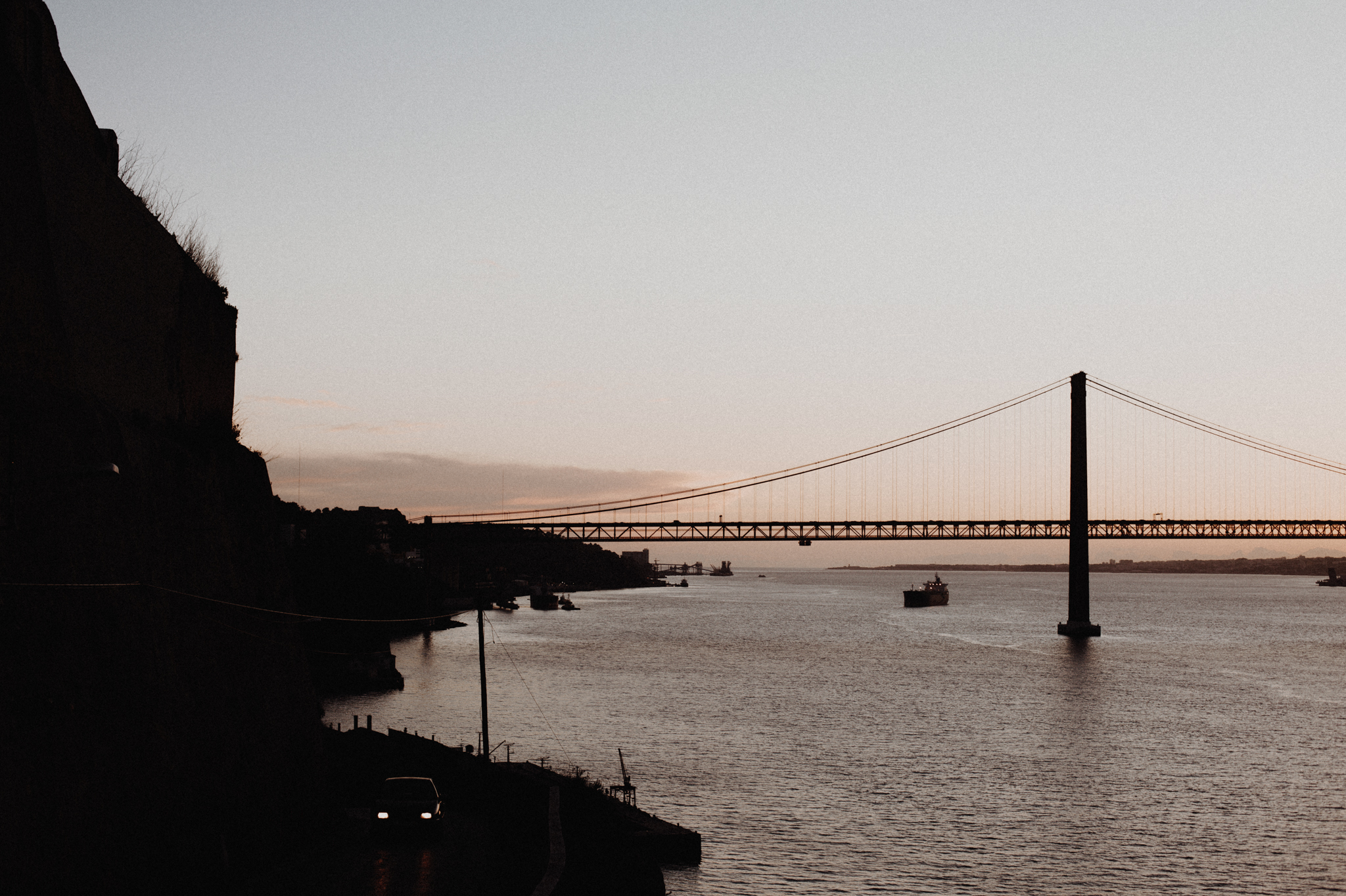 view of Ponte 25 de Abril bridge during sunset on tagus river from boca do vento