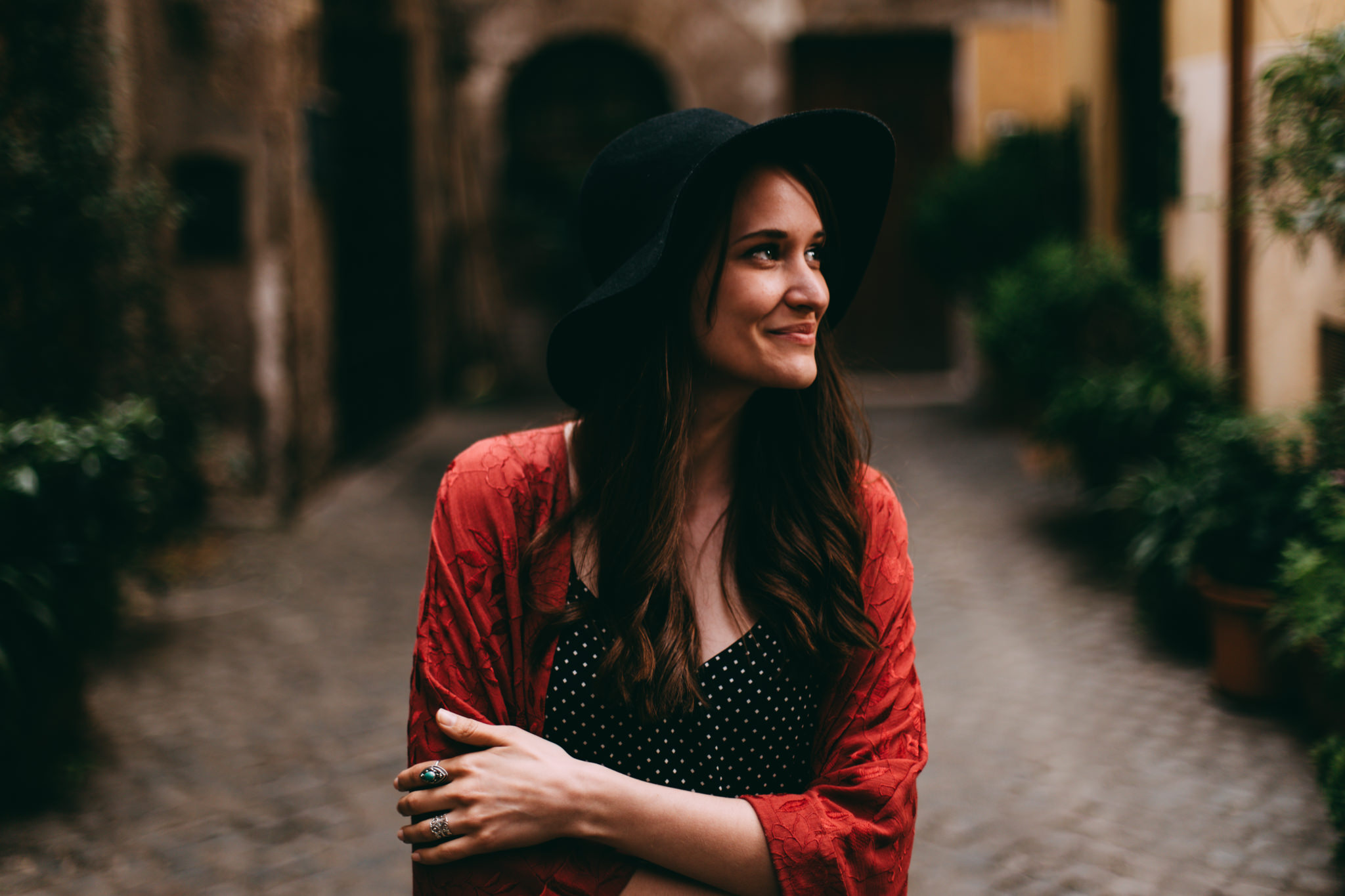 woman smiling in street of trastevere