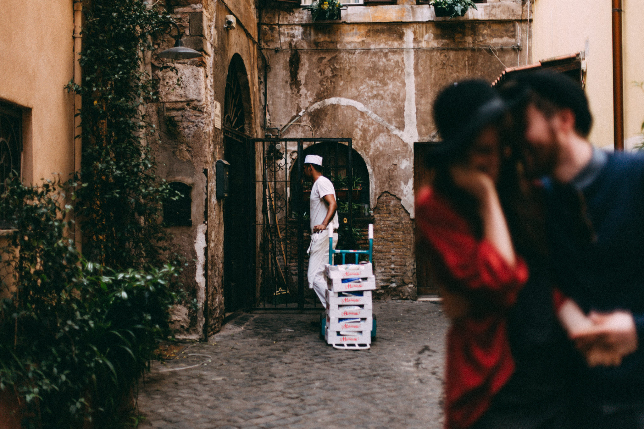 blurry photo of couple in rome