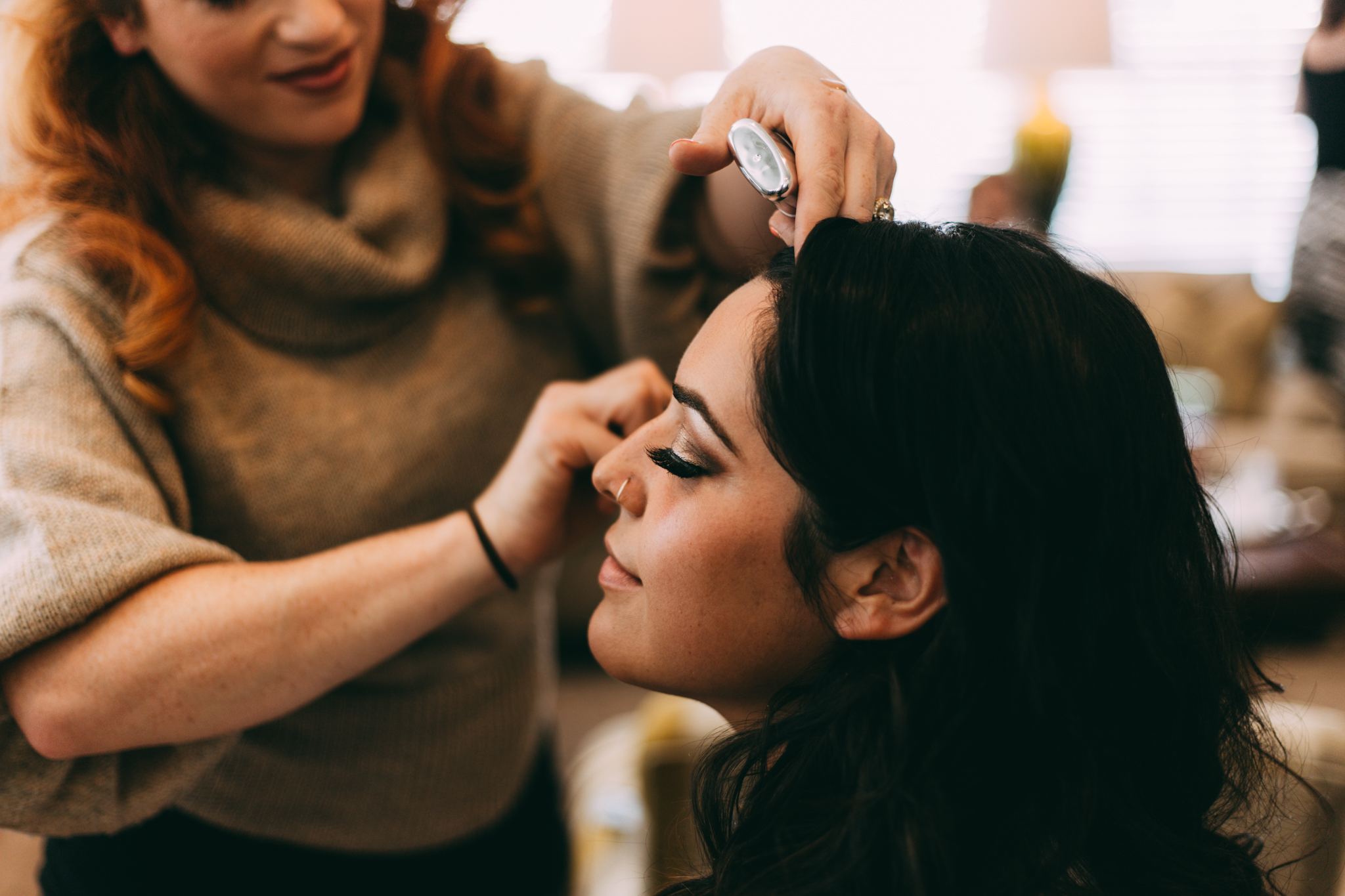 bride getting makeup done by stylist