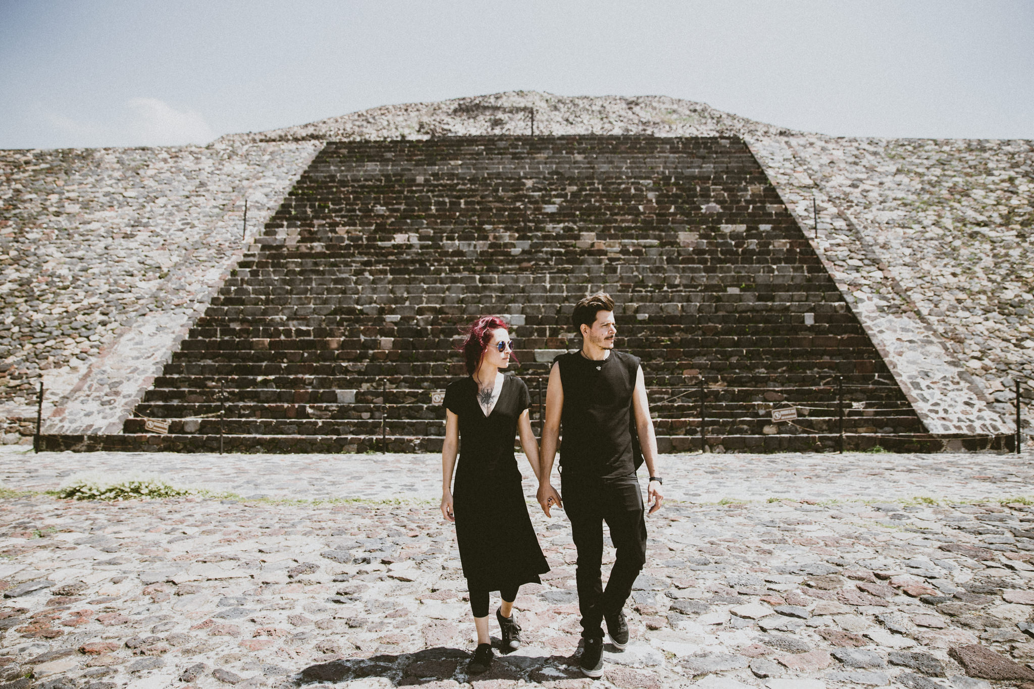 couple in teotihuacan mexico walking on pyramid of the moon