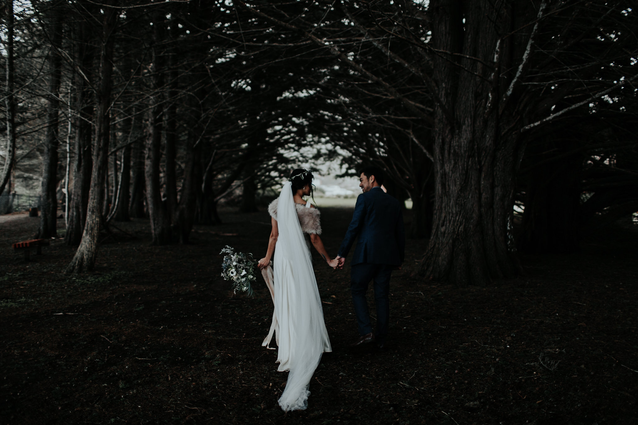 moody dark bride and groom romantics at tree grove ragged point inn big sur pine trees winter wedding