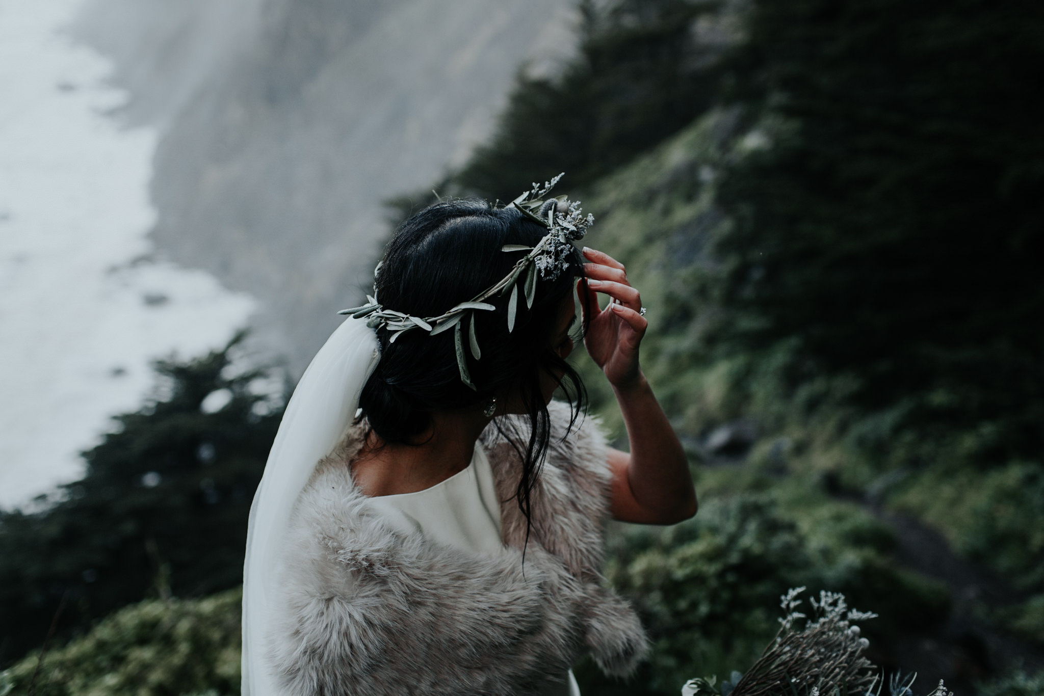moody winter january wedding coastal big sur ragged point flower crown and fur wedding dress