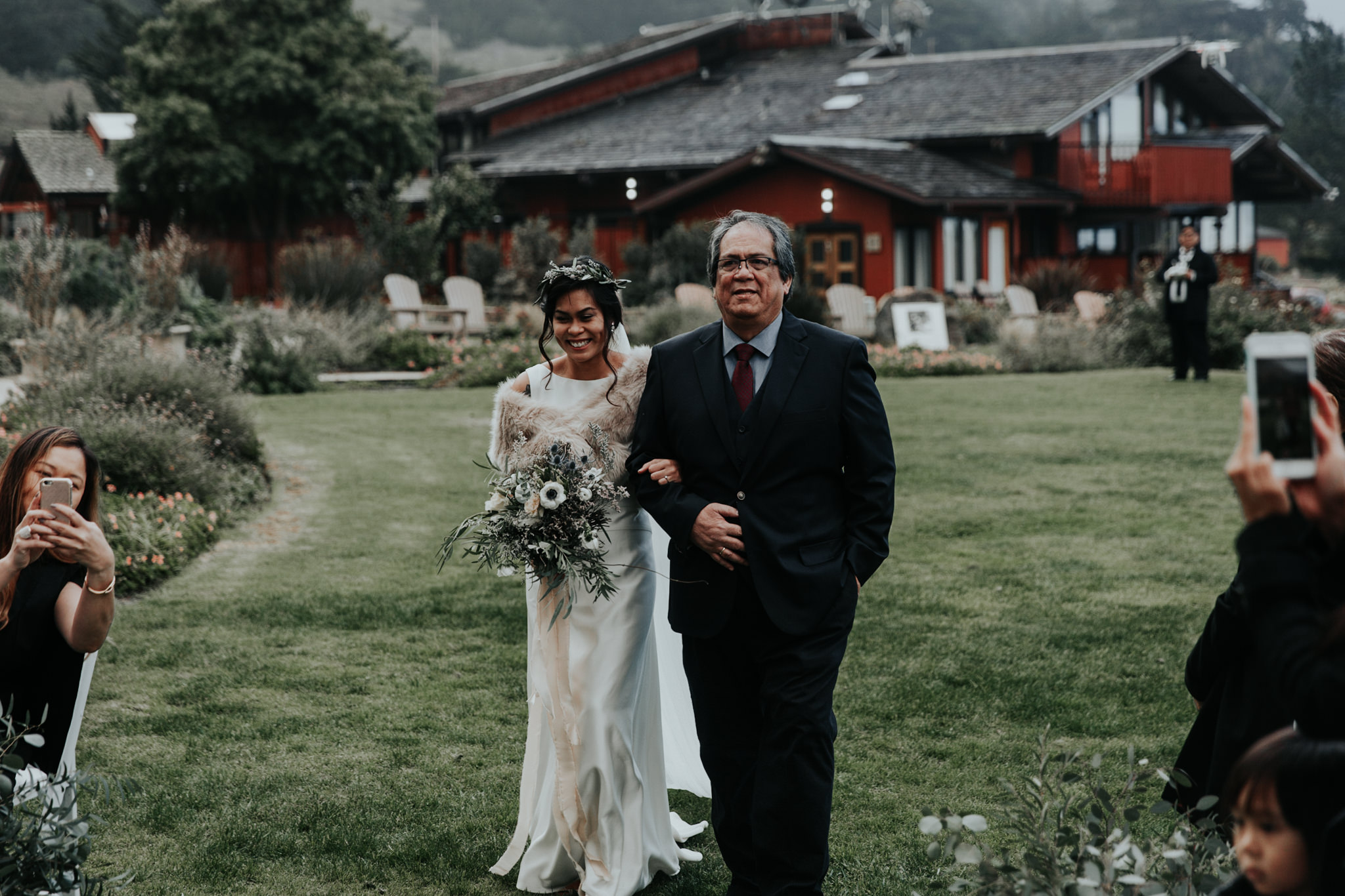 father and daughter bride walking down aisle at ragged point inn winter elopement wedding