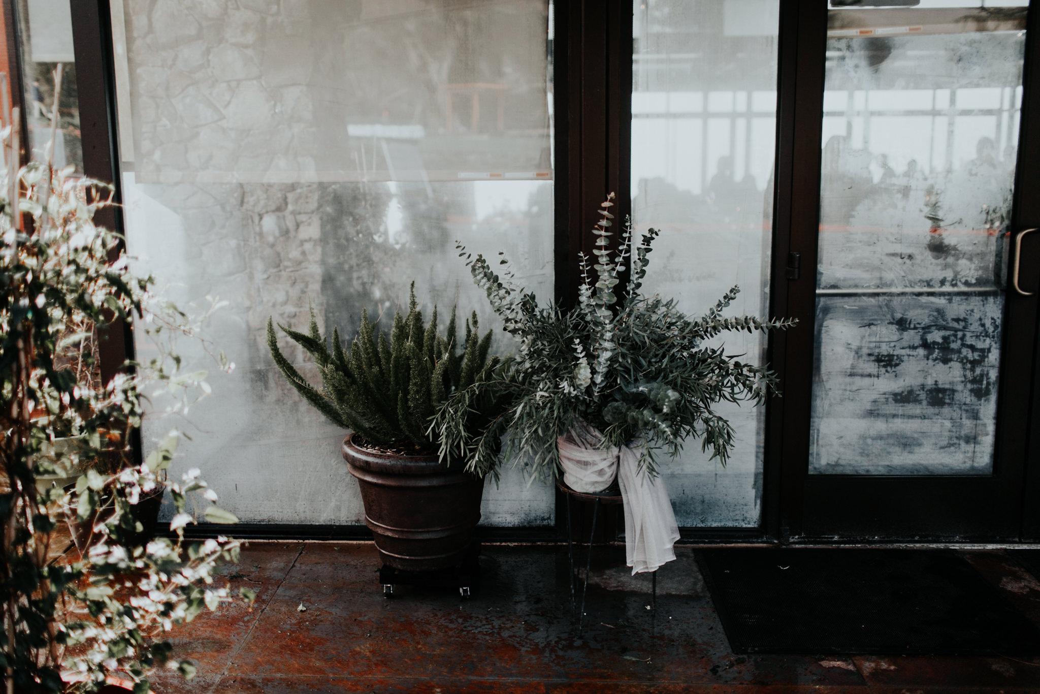 moody eucalyptus wedding florals for winter wedding reception