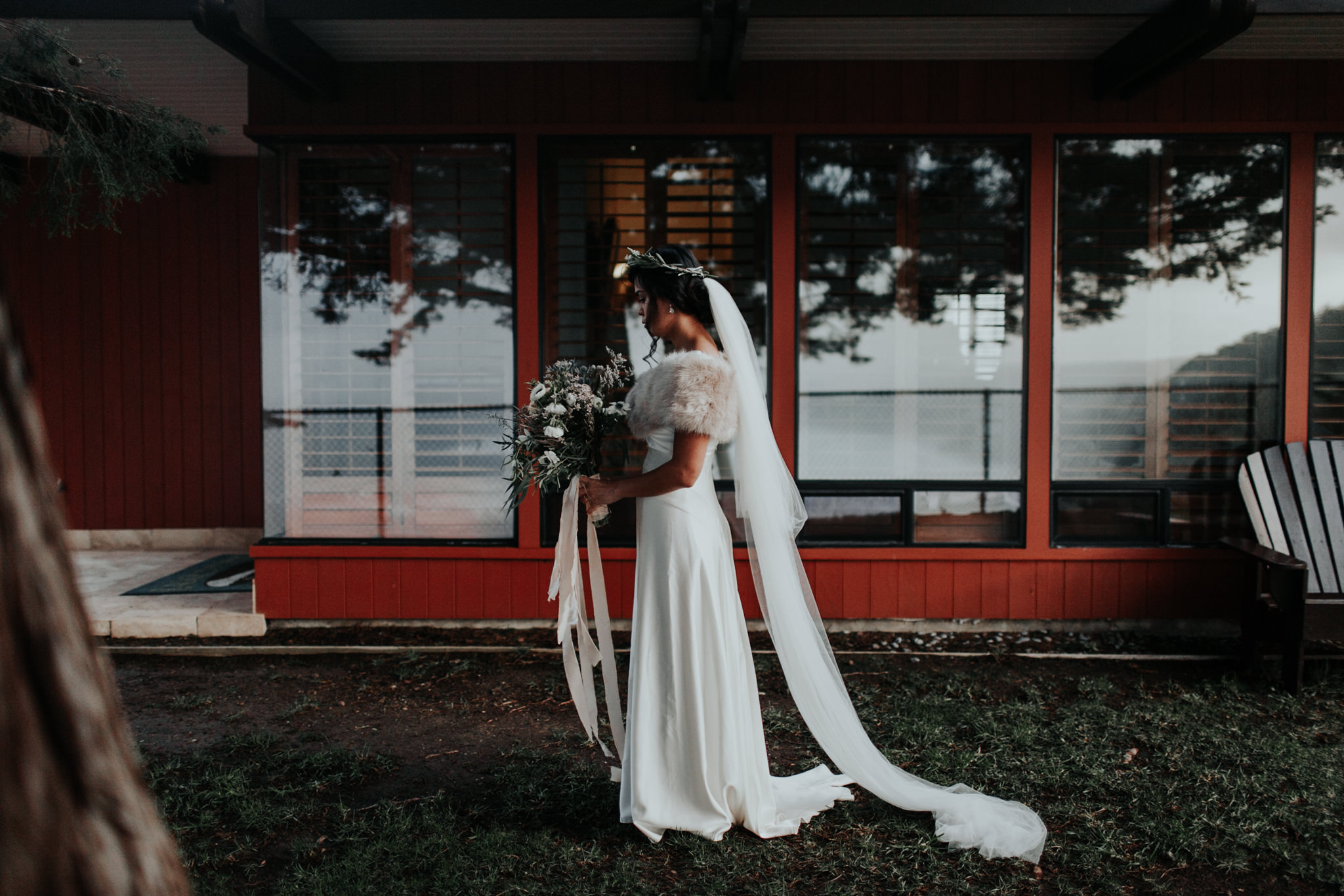 bridal bride winter wedding dress with fur and bouquet moody big sur ragged point inn