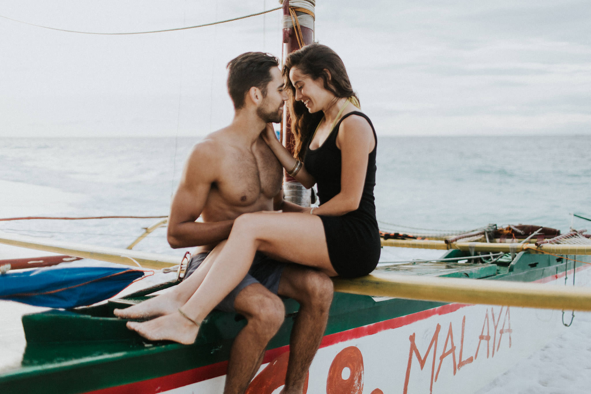 sailboat couples portrait in boracay boat puka beach